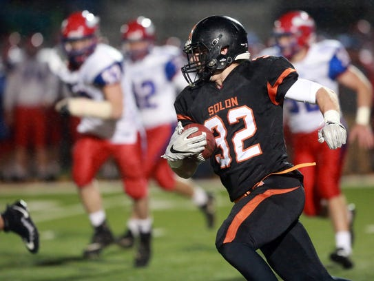 Solon's Adam Bock runs down field during the Spartans'