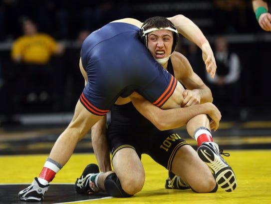 Iowa's Michael Kemerer wrestles Illinois' Kyle Langenderfer
