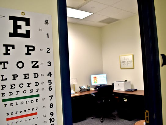 An eye chart hangs on the wall in the newly opened