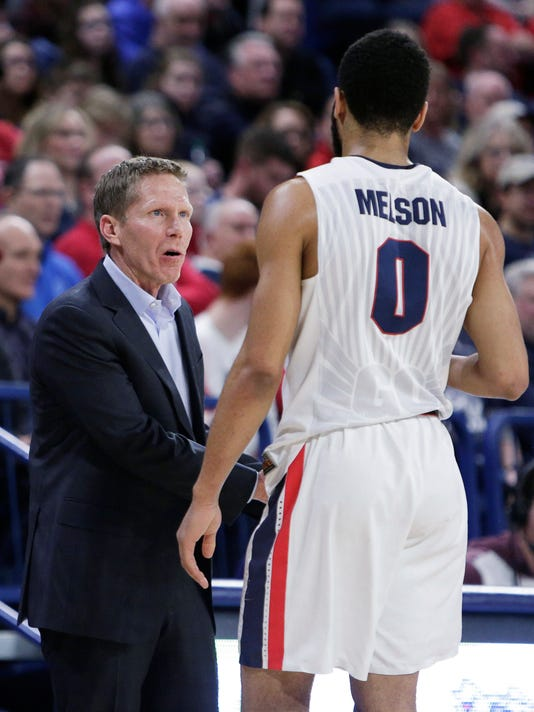 Gonzaga head coach Mark Few, left, speaks with guard Silas Melson during the first half of the team's NCAA college basketball game against San Diego in Spokane, Wash., Thursday, Feb. 1, 2018. (AP Photo/Young Kwak)