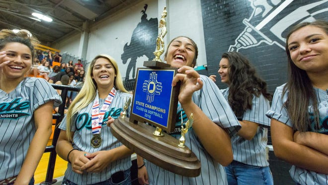 Oñate High School softball players celebrate on Monday, May 23, 2016 during their state title celebration in the gymnasium. Pictured from left to right, Kristiana Romero, 16, backup catcher; Krystal Vaca, 17, catcher; Sierra Gonzalez, 18, pitcher; Rosie Ayala, 16, outfield; and Sienna Sedillo, outfield.