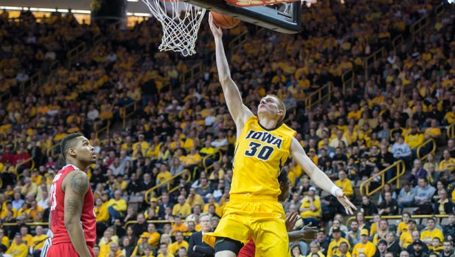 Iowa forward Aaron White (30) goes to the basket during the Hawkeyes' win against Ohio State on Saturday. After beating the Buckeyes, Iowa sits at 4-1 in the Big Ten but it has a big challenge Tuesday against the No. 6 Wisconsin Badgers.