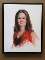 A painting of Sara Boyd, the wife of Chad Boyd, CFO, TwelveStone Health Partners, in Boyd's office Tuesday, April 12, 2016. Boyd is a self-taught portrait painter, who painted this portrait of his wife.