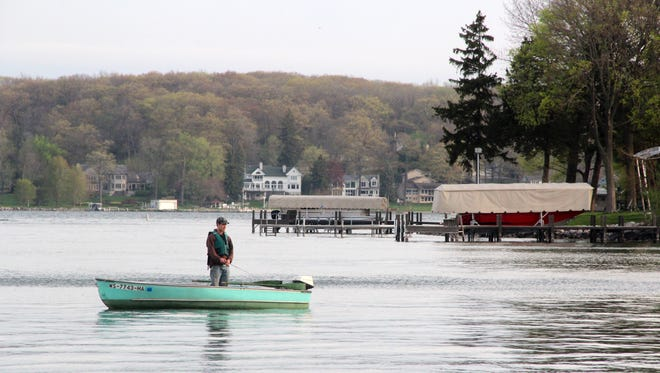An angler fishes May 7 on Pewaukee Lake on opening day of the 2016 Wisconsin general fishing season.
