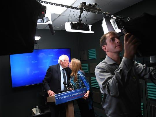 Presidential candidate, Bernie Sanders kisses his wife,