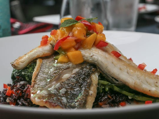 Nunzio's Dolce Vita, 90 South Street, Morristown on July 27, 2016. Broiled Bronzino - Heirloom Rice, Broccoli Rabe, Olives, Capers, Lemon, Roasted Garlic, Tomato and Wine Broth.