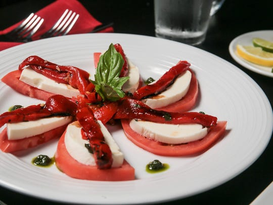 Caprese Salad - House-made Mozzarella, Vine Ripe Tomato, Balsamic, Roasted Peppers, Pesto Oil, and Basil, at Nunzio's Dolce Vita, 90 South Street, Morristown.