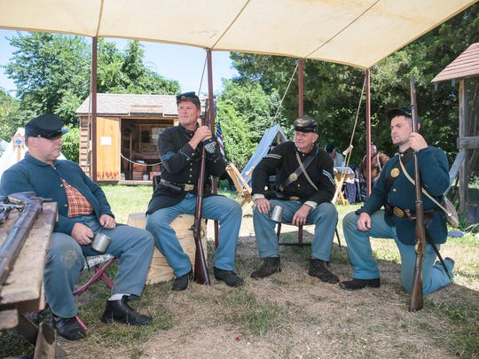 From left, soldiers Andrew Megill of Point Pleasant, Jim Heine of Wall, Jerry Kennedy of Barnegat, and  Brian Holt of Lacey at a Civil War encampment by the 61st New York Regiment of Civil War Soldiers at Brick Historical Society's Haven's Homestead Museum on August 7, 2016.