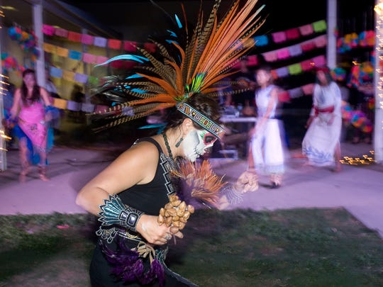 Veronica Valadez, part of the Aztec Dancer's group, performs at the celebrations for Dia de los Muertos event last year.