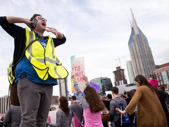 Event organizer Shawn Reilly, of Nashville, cheers on demonstrators during a march in solidarity with the Women's March on Washington, Saturday, Jan. 21, 2017, in Nashville, Tenn.