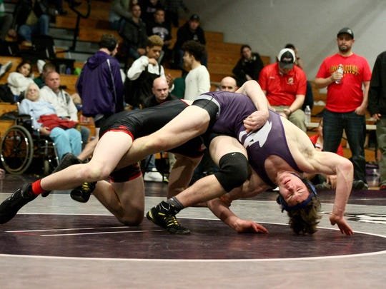 Shasta High's Quinn Simard wrestles against Chico's Jackson Blankenship on Saturday in the 172-pound title match at the EA-SRL championships. Simard won 7-5.