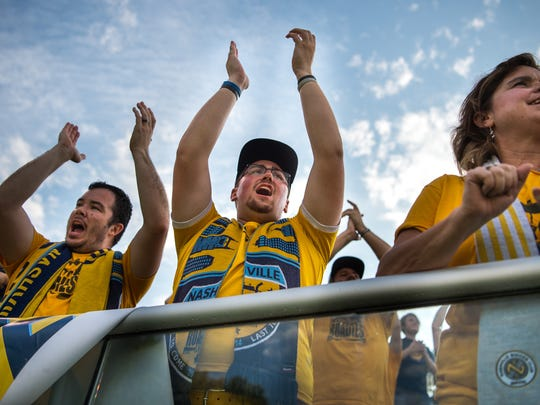 Nashville SC fan Carter Moles, center, of Nashville,
