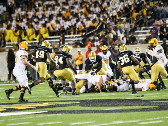 The Hornet defense swarms to the ball.  ASU battled