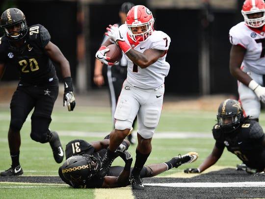 Georgia running back D'Andre Swift (7) slips past Vanderbilt