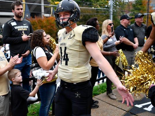 Vanderbilt quarterback Kyle Shurmur (14) heads into the stadium before a game between Vanderbilt and Western Kentucky at Vanderbilt Stadium in Nashville, Tenn., Saturday, Nov. 4, 2017.