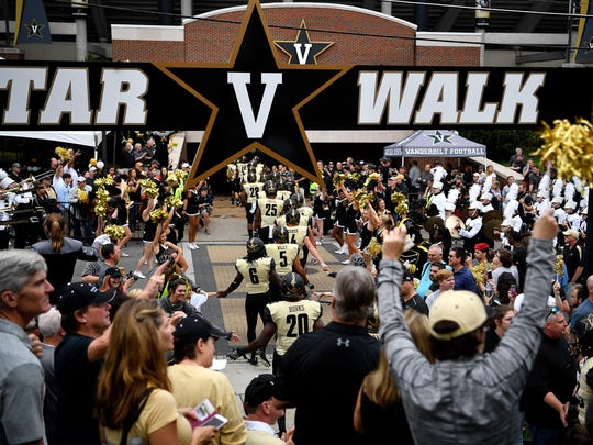 Vanderbilt players head into the stadium before a game between Vanderbilt and Western Kentucky at Vanderbilt Stadium in Nashville, Tenn., Saturday, Nov. 4, 2017.
