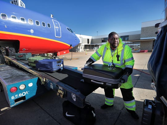 Patrick Worship unloads baggage from a Southwest flight