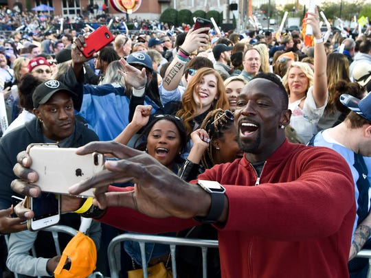 Former Tennessee Titan Jevon Kearse greets fans before the Titans uniform reveal event held at Broadway and 1st Avenue in Nashville, Tenn., Wednesday, April 4, 2018.