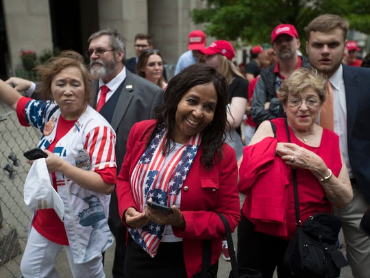 Congressional candidate Charlotte Bergmann speaks to people in line outside of a rally by President Donald Trump at Municipal Auditorium in Nashville, Tenn., on Tuesday, May 29, 2018.