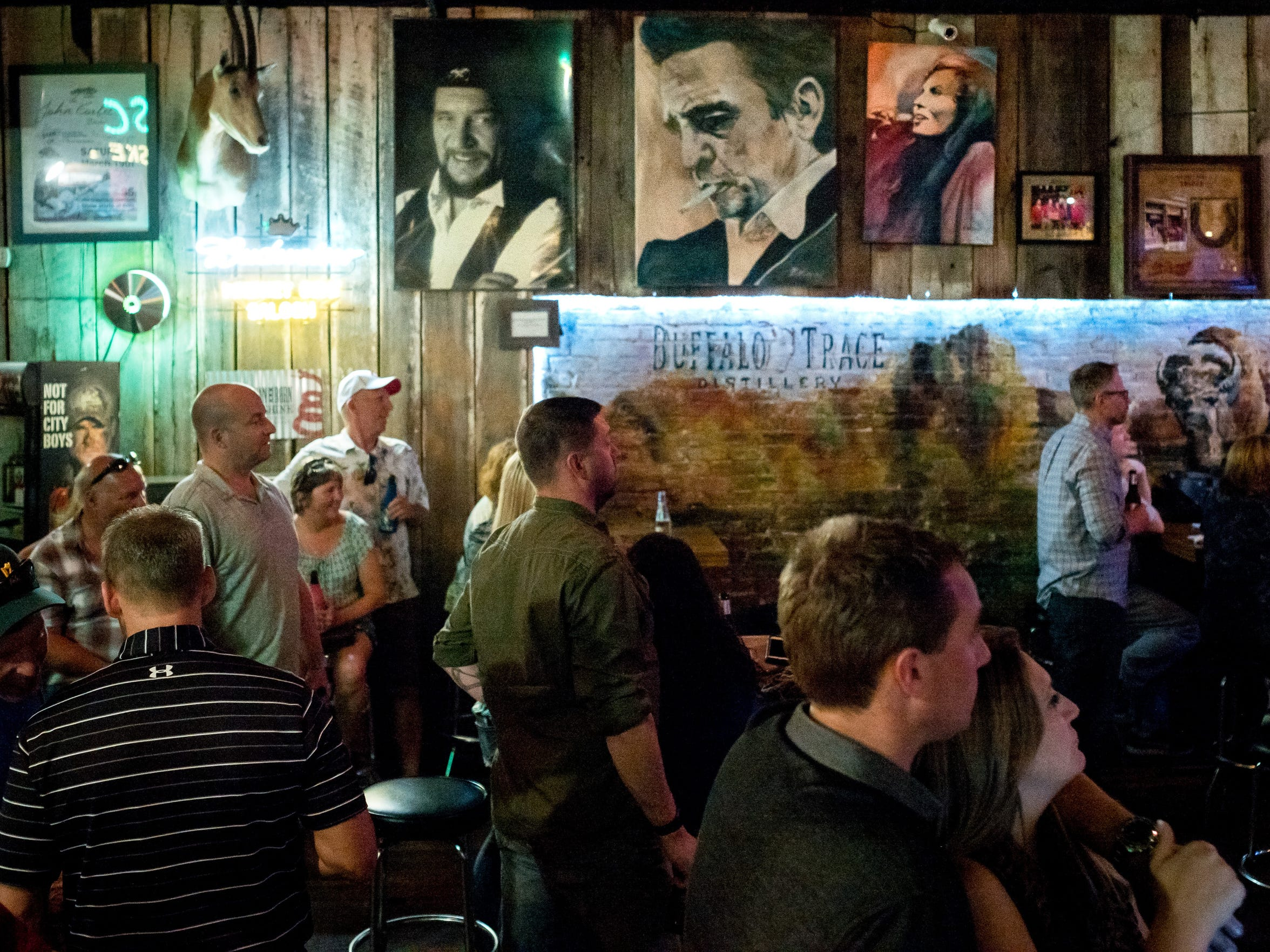 Guests listen as a band performs performs at Whiskey Bent Saloon, Wednesday, May 23, 2018, in Nashville, Tenn.