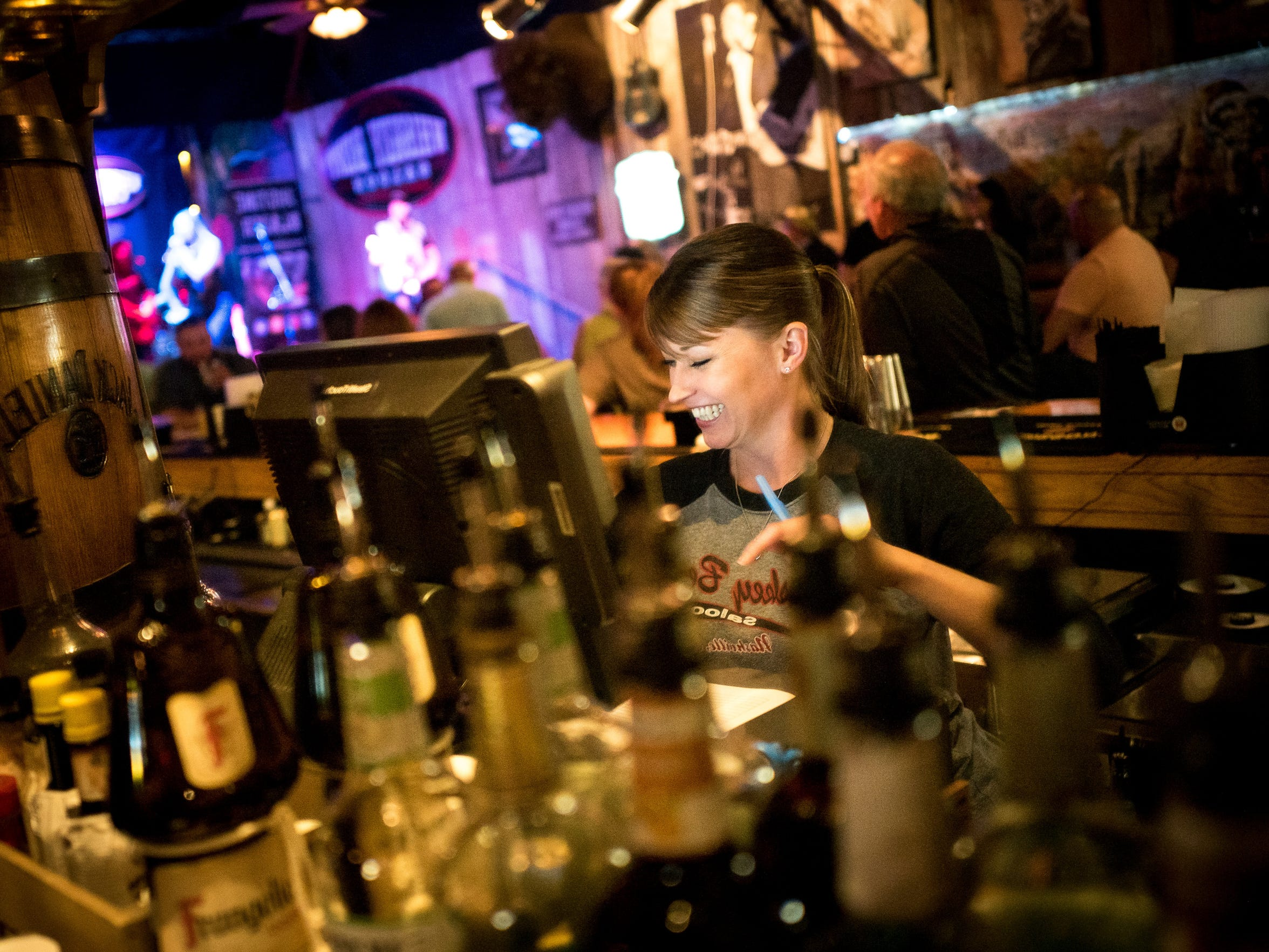 Melissa McMahan, general manager and bartender, rings