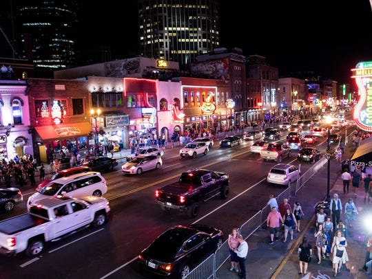 Traffic passes down Broadway in Nashville on Thursday,