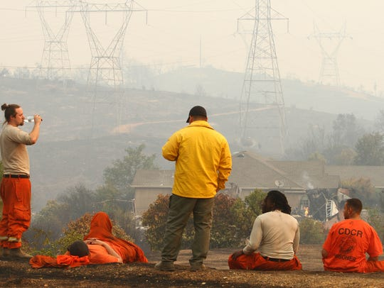 Exhausted crews fighting the Carr Fire are seen in late July 2018. (Hung T. Vu/Special to the Record Searchlight)