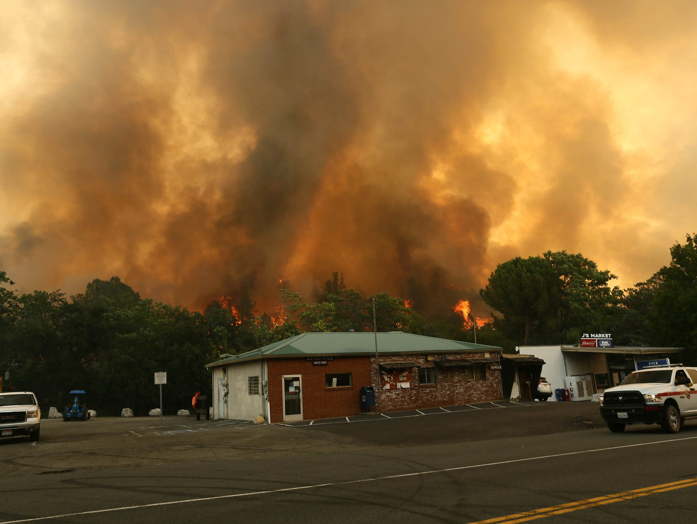 As seen July 26, 2018, the Carr Fire burns behind J's Market in Shasta. (Hung T. Vu/Special to the Record Searchlight)