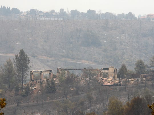 A view of the destruction in Redding from the Carr Fire at neighborhoods surrounded by open space.