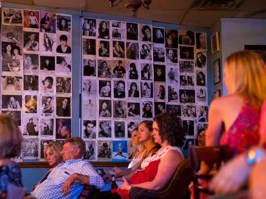 The walls are covered with signed pictures of musicians at the Bluebird Cafe in Nashville, Tenn. on Friday, July 27, 2018.