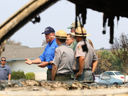 Secretary of the Interior, Ryan Zinke, stops for a quick questions and answers to the press at the corner of Puffin Way and Cape Cod Dr. while touring houses that were destroyed by the Carr Fire in the Keswick Dam Road area by Quartz Hills Rd. on Sunday morning.