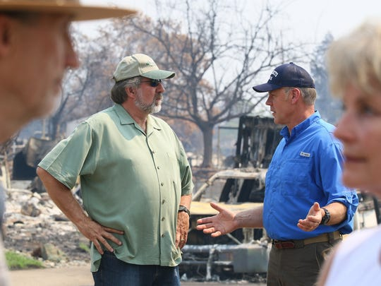 Rep. Doug LaMalfa, left, speaks with former U.S. Secretary of the Interior Ryan Zinke on a Carr Fire tour.