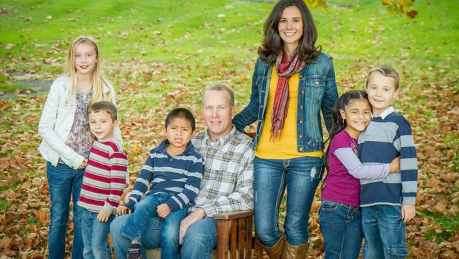 Tim and Angie Eberhard, of Keene Township, have expanded their family by adopting two children from Ecuador. From left are Haley, Wade, David, Tim, Angie, Natalia and Russ Eberhard.