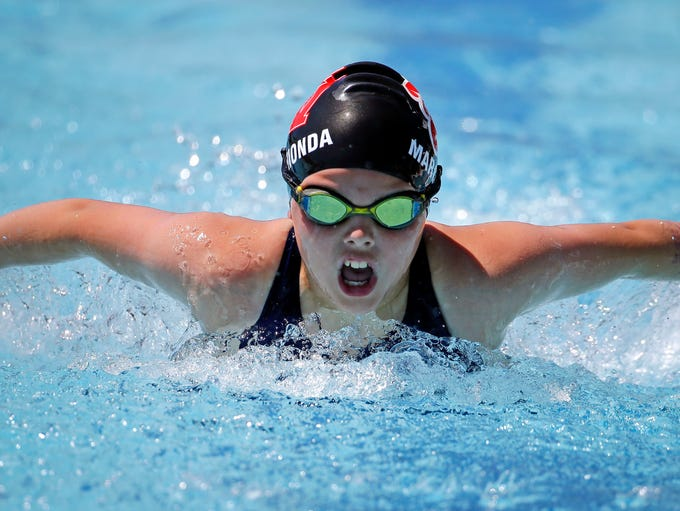 Nadia Marchionda of the Fox Valley Wave Swim Team competes
