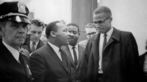 Martin Luther King Jr. and Malcolm X wait for a news conference on March 26, 1964.