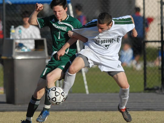 02/19/10--Photo by Craig Bailey/Florida Today--Melbourne's Jordan Snell tangles with Seminole player Shane Wixted during Saturday's Class 5A state soccer title game.