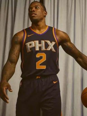 Phoenix Suns guard Eric Bledsoe models one of the Suns 'statemet' jerseys
