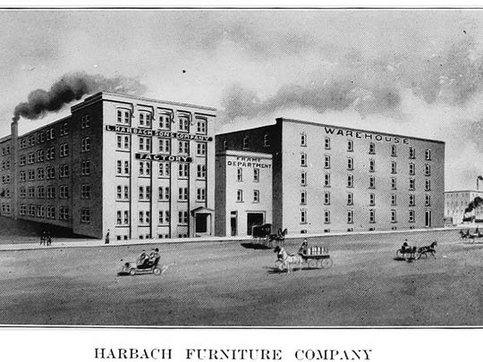 The Harbach Furniture buildings were constructed in 1906 on the south side of downtown Des Moines. The smaller building in the middle has since been demolished.