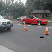 One lane of northbound Abbot Road in East Lansing is closed because of a sinkhole.