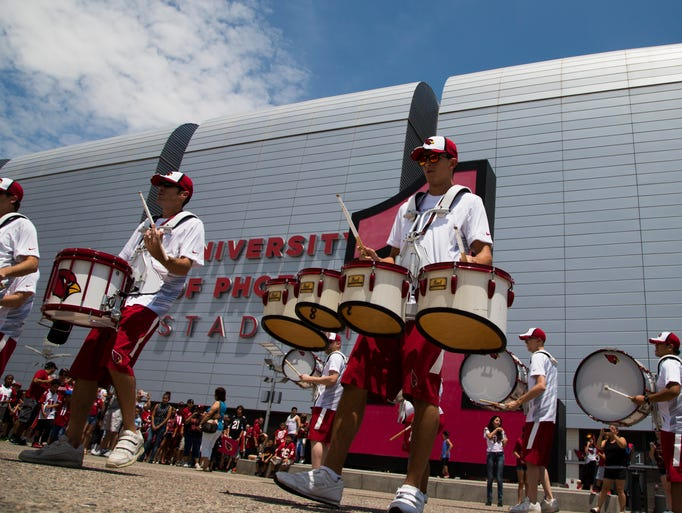 A drumline entertains fans before doors open during Cardinals Fan Fest in Glendale onSaturday, August 2, 2014.