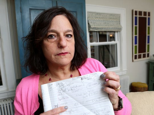 Janet Berg of Ossining has been fighting over EZPass and cashless tolling for a dozen years, getting the runaround from EZPass NJ, EZPass NY, The Port Authority, the DMV and collection agencies. It got so bad, she faced nearly $5,000 in fines and she was days from having her registration suspended. She took $5K from her IRA to pay her debt in tolls and fines. Berg with her notes from the bills at home in Ossining Feb. 6, 2018.