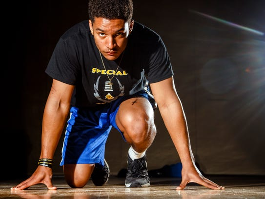 South East Polk sprinter Gavin Williams stands for