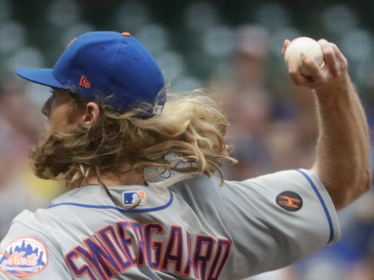 New York Mets starting pitcher Noah Syndergaard throws during the first inning of a baseball game against the Milwaukee Brewers Friday, May 25, 2018, in Milwaukee.