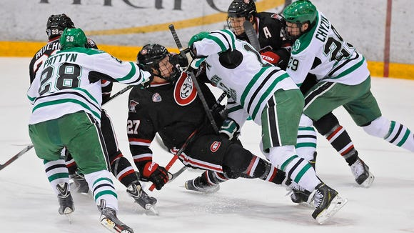 St. Cloud State's Nick Oliver (27) and Connor Gaarder (13) of North Dakota collide in the middle of the action during the first period of the Nov. 21 game at the Herb Brooks National Hockey Center in St. Cloud.