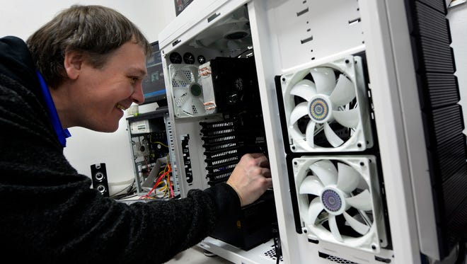 Computer tech Mike Gaffney builds a new gaming computer at Alliance Computers, 984 Loucks Road, Monday, Dec. 21,2015. Alliance Computers accepts electronics for recycling at no charge to the customer except for CRT computer monitors ($4) and large TV's ($10). (John A. Pavoncello - The York Dispatch)