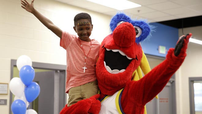 Josiah France, 6, is held in the air by Indiana Fever mascot Freddy Fever during an open house for the new Finish Line Boys & Girls Club, opening at 38th Street and Post Road. The $4.5M facility will serve Far Eastside youth ages 5-18  The center opens for the summer June 13.