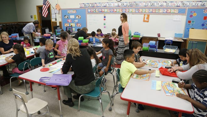 In this 2015 file photo, volunteers help during Kindergarten Countdown  at Glen Acres Elementary School. Lafayette schools are coping with an enrollment boom that started four years ago.