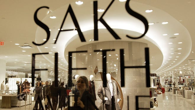 **FILE** A Saks Fifth Avenue store is seen in Boston, in this Nov. 13, 2006 file photo. Saks Inc., parent of the tony Saks Fifth Avenue department store chain, on Wednesday, March 7, 2007 posted a fourth-quarter profit, reversing a year-ago loss, as sales climbed 17 percent on improved customer traffic. (AP Photo/Chitose Suzuki, file)