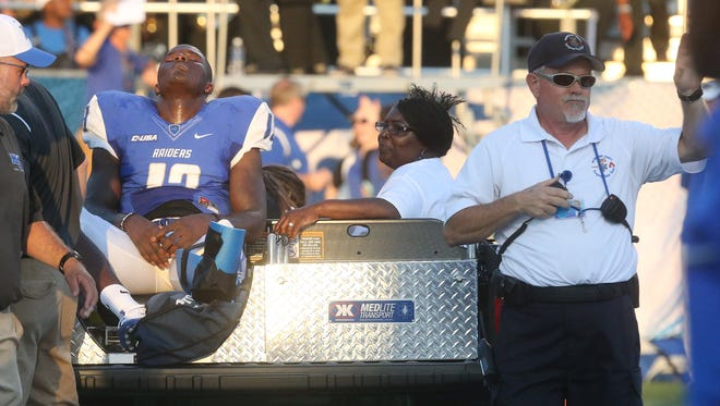 MTSU's Demetrius Frazier (13) gets taken off the field after being injured while scoring a touchdown during a home game against Alabama A&M's, on Saturday, Sept. 3, 2016.