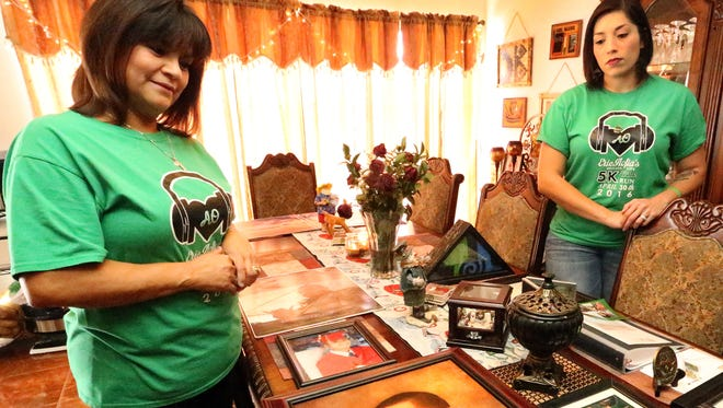 Alicia Aofia, left, Eric Aofia's mother, and Mandy Aofia, right, his widow, discuss their trip to the Tournament of Roses Parade in Pasadena, Calif., during which Eric will be honored on a parade float. When he died in August 2015, his organs helped save the lives of five people. One of his organs was donated to science.